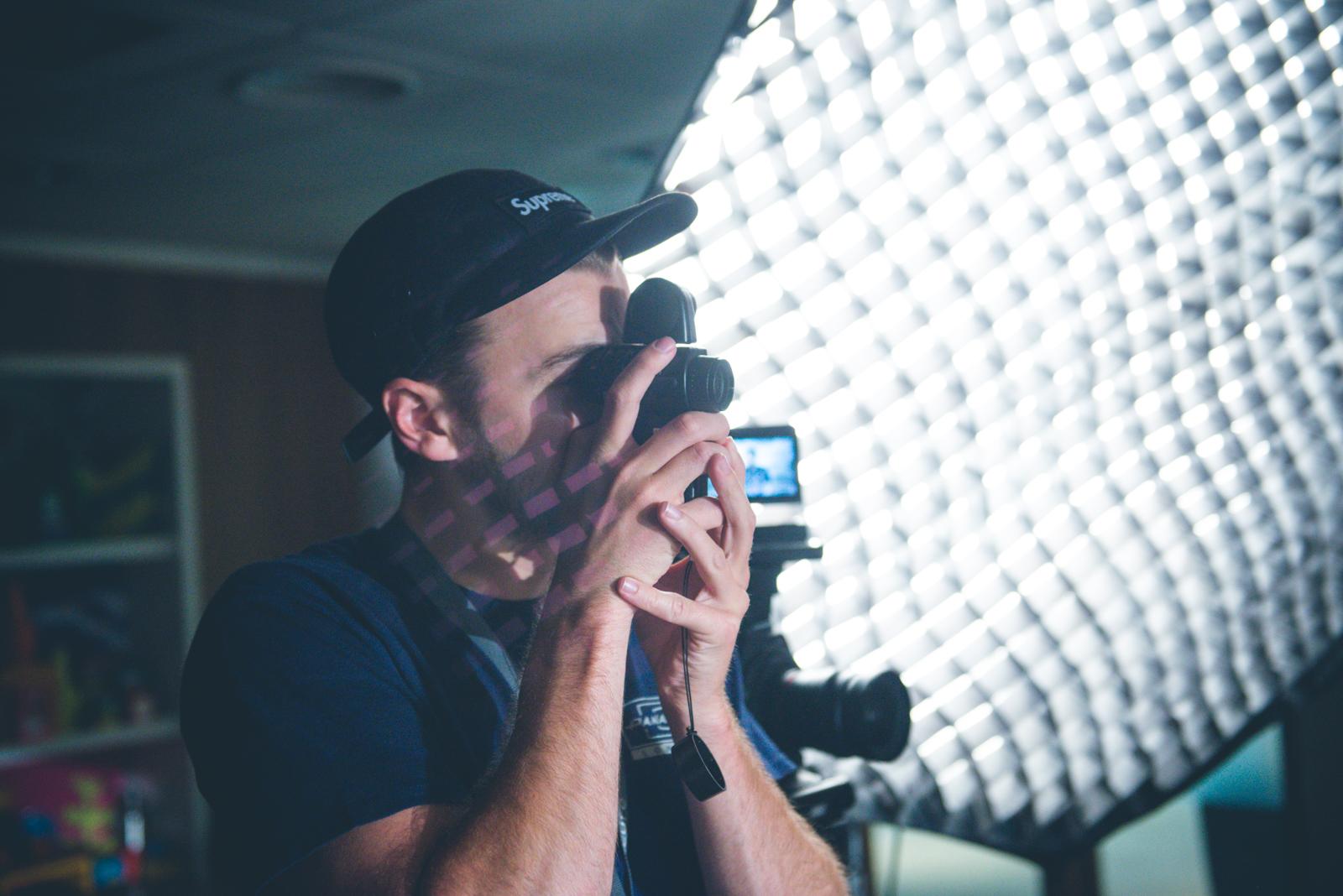 True - person using camera