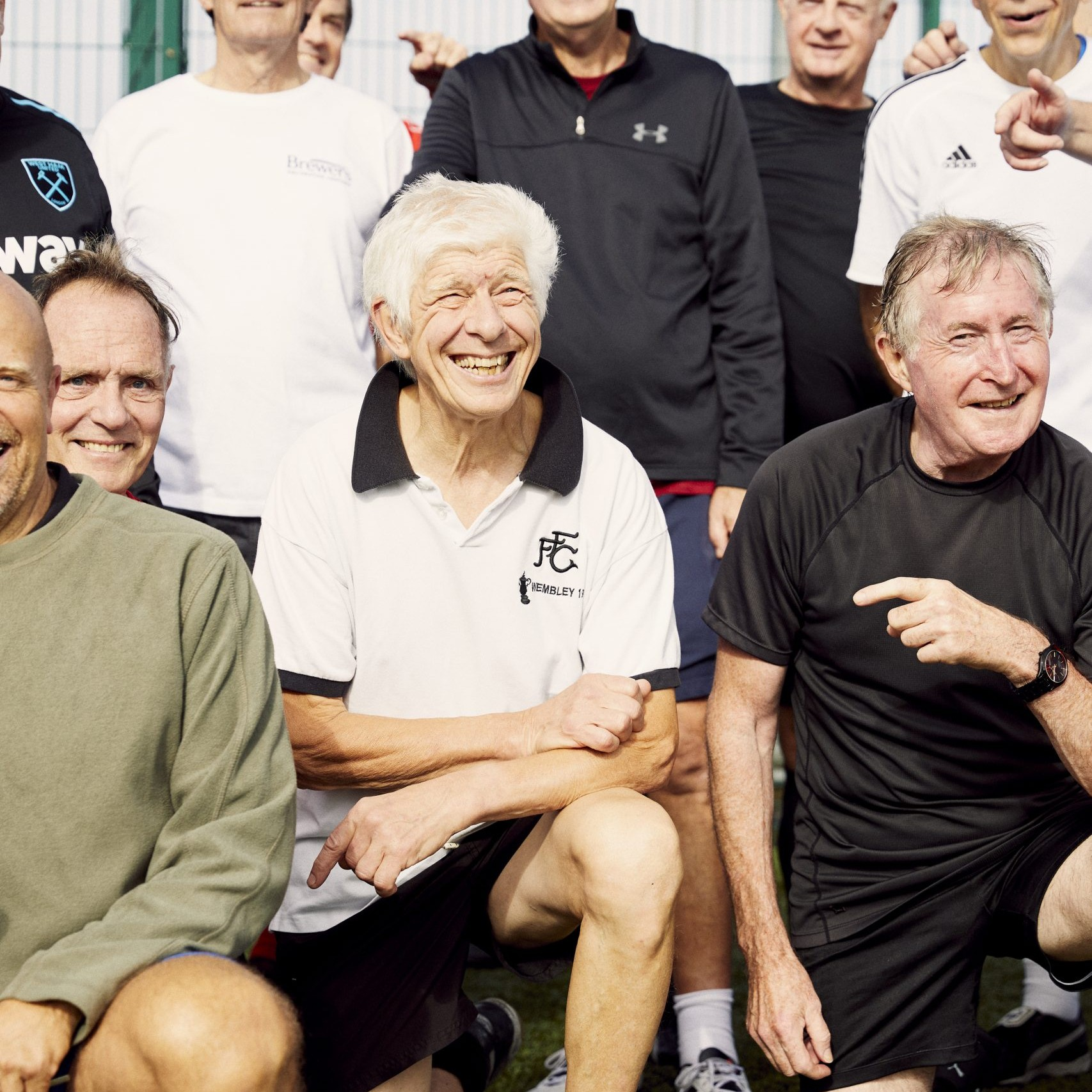 Group of elderly playing football
