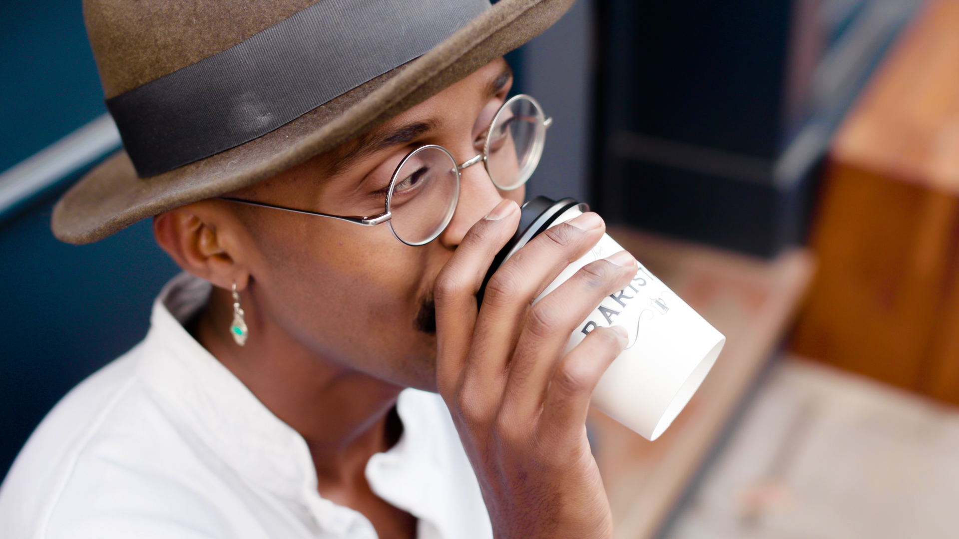Gentlemen Barista - close up of person drinking coffee