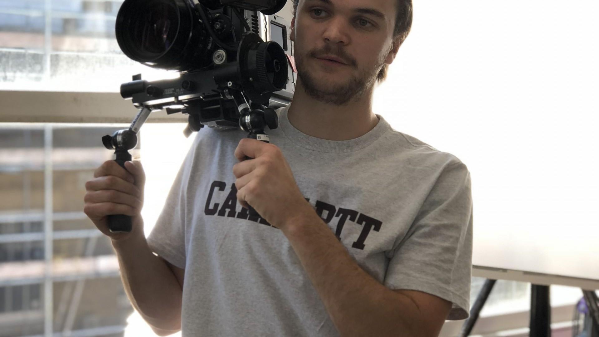 Habitual Media - person holding camera